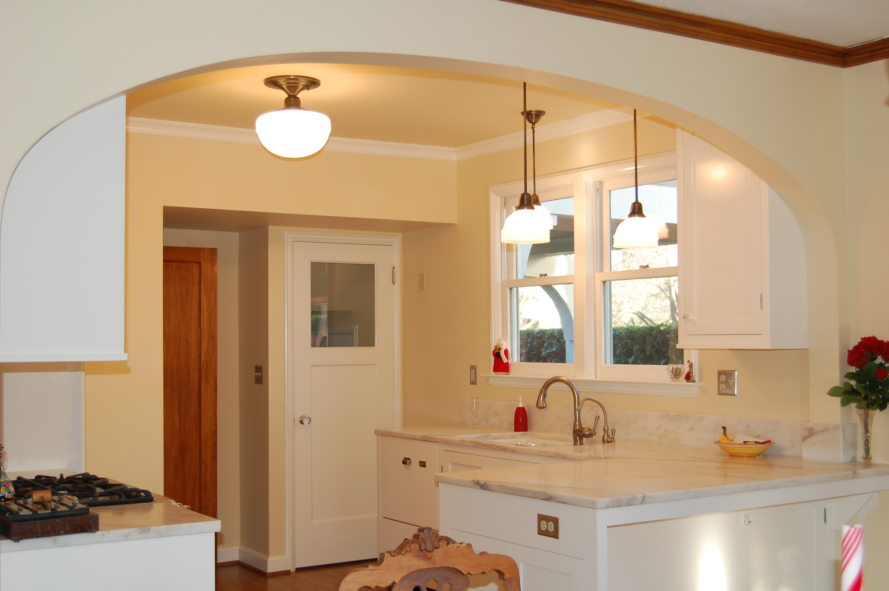 Kitchen detail with arch to match existing elsewhere in home reconfigured doorways